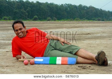 ein Dorf Sportler ruht auf einem Strand