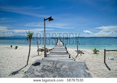 Old wooden pier on the beach Kanawa Indonesia poster