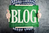 Teacher holding green chalkboard with title BLOG. Blogging concept. poster
