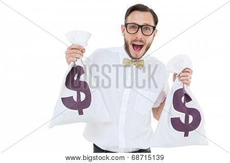 Geeky businessman holding money bags on white background
