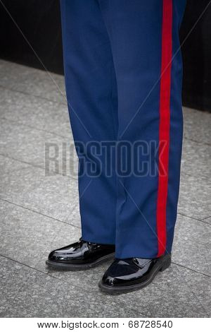 NEW YORK - MAY 23, 2014: Blue trousers with the scarlet blood stripe of a U.S. Marines Corpsmen participating in the re-enlistment and promotion ceremony at the National September 11 Memorial site.