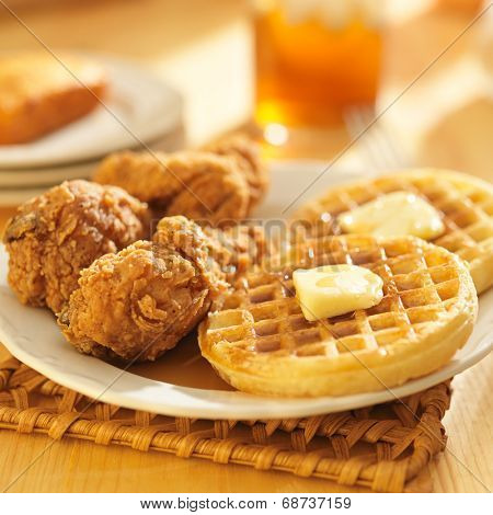 chicken and waffles with corn bread & sweet tea in background