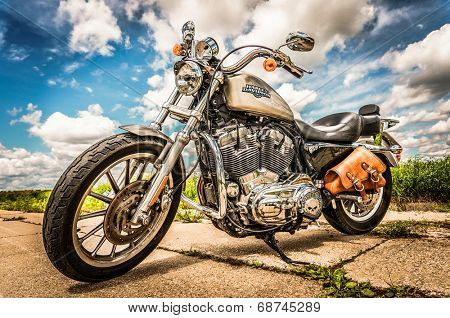 RUSSIA-JULY 7, 2013: Harley-Davidson Sportster 883 Low. Harley-Davidson sustains a large brand community which keeps active through clubs, events, and a museum. Filter applied in post-production.