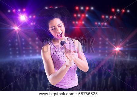 Pretty girl singing against digitally generated nightclub under lights poster
