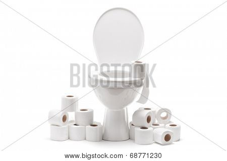 Pile of toilet paper around a toilet bowl isolated on white background