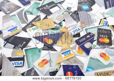 Ankara, Turkey - October 17, 2012 : Studio shot of pieces of three major credit cards Visa, MasterCard and American Express