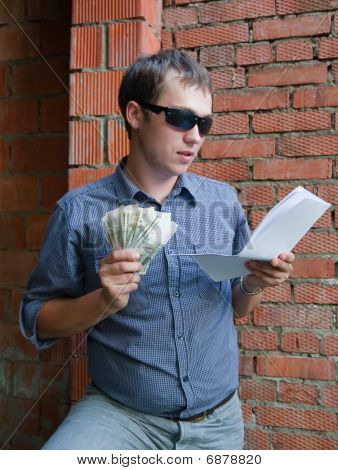 Happy Worker With Documents And Money