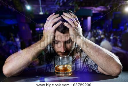 Alcoholic Drunk Man thinking On Alcohol Addiction At Disco Nightclub