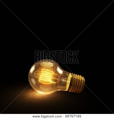 Glowing Incandescent Light Bulb On A Dark Background