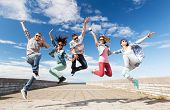 summer, sport, dancing and teenage lifestyle concept - group of teenagers jumping poster