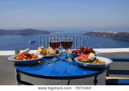 Ideal breakfast with wonderful seaview on caldera, Santorini island, Greece poster