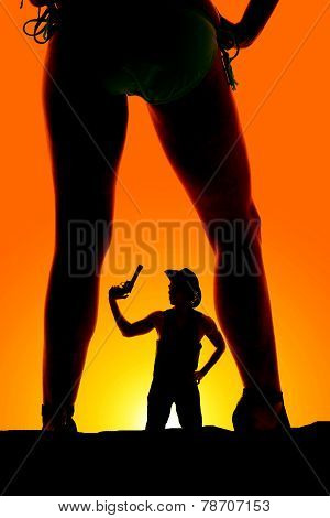 Silhouette Of A Cowboy With A Gun Up In His Hand