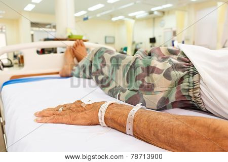 Patient Lie On Bed In Emergency Room