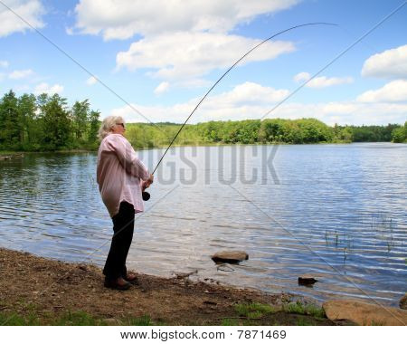 Senior woman fly fishing Wilderness