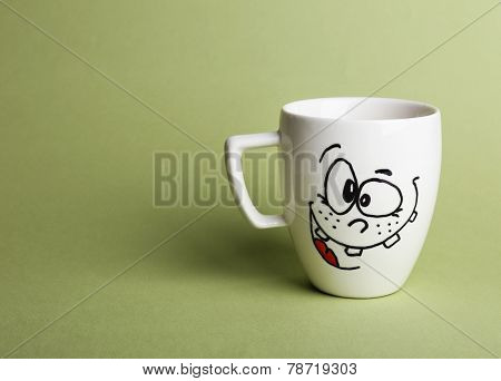 Emotional cup on green background