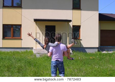 Couple entering their new house