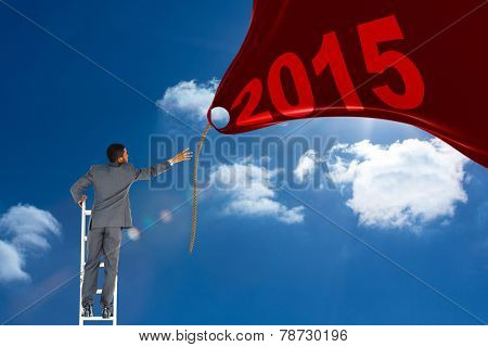 Businessman standing on ladder against bright blue sky with clouds