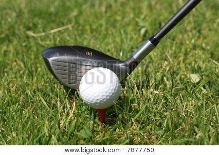 Golfball On Tee And Golfclub