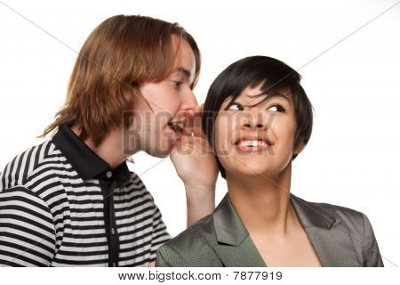 Attractive Diverse Couple Whispering Secrets