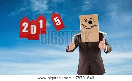 Anonymous businessman with thumbs up against blue sky