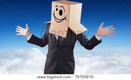 Anonymous businessman with hands out against blue sky over clouds