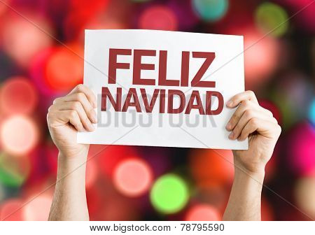 Merry Christmas (in Spanish) card with colorful background with defocused lights