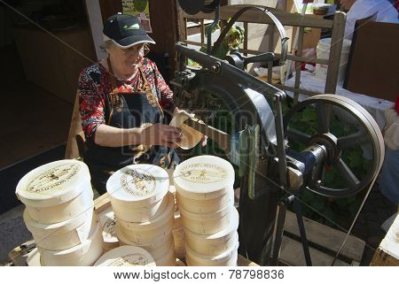 Lady produces wooden boxes for cheese Affoltern im Emmental, Switzerland.