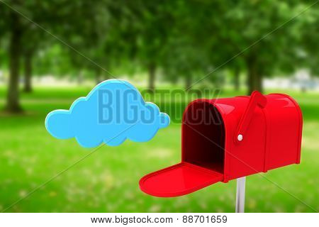 Red email postbox against park poster