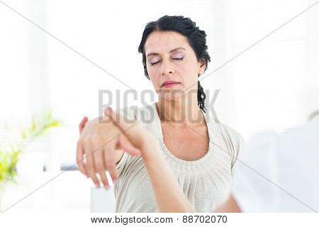 Hypnotized woman with her therapist on white background