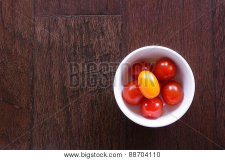 Cherry Tomatoes On Dark Wood