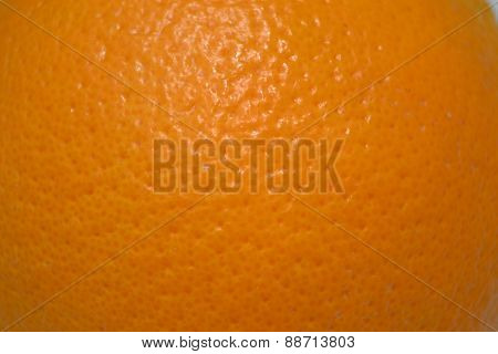 orange peel texture of orange on table poster