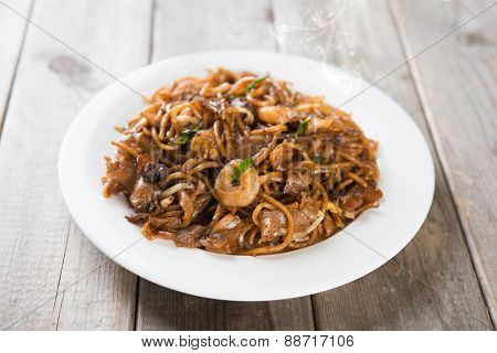 Fried Char Kuey Teow, popular noodle dish in Malaysia and Singapore.