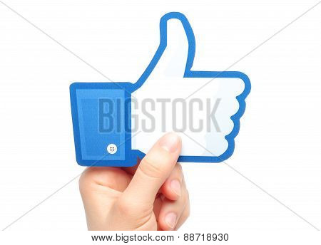 KIEV UKRAINE - MARCH 7 2015: Hand holds facebook thumbs up sign