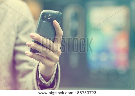 Woman with mobile phone in hand