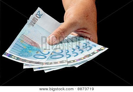 Hand full of 20 euro notes
