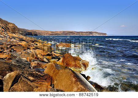 Orange Rocks On Sunny Shore In Spring