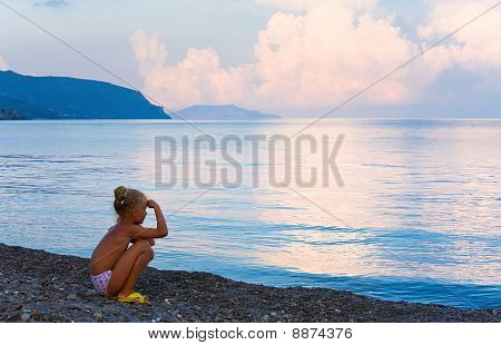 Sunset, Shining Sea Surface And Girl On Beach