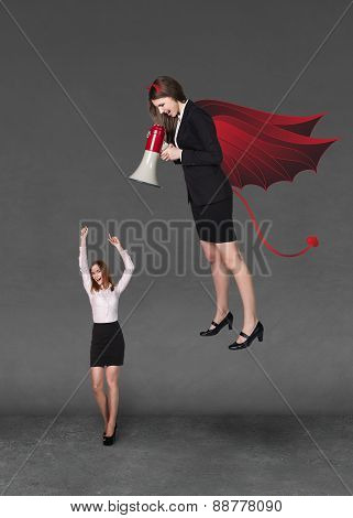 Devil businesslady with a megaphone screeming