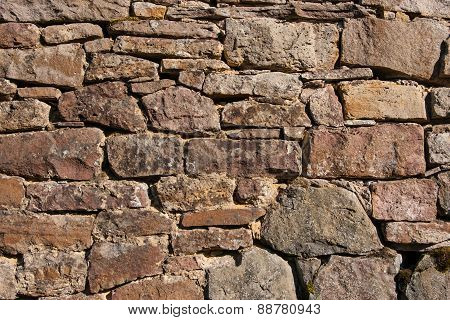 Wall of carved natural stone