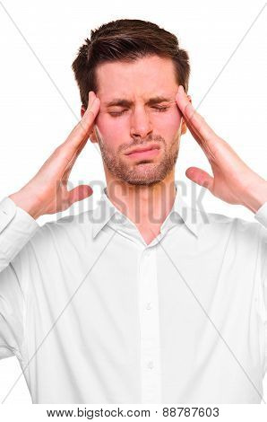 A young man grasping his head where the pain is - a killer headache or migraine. isolated on a white background. poster