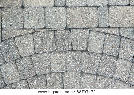 Circular Inlaid Pattern In Grey Brickwork