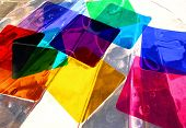 gelatin filters afloat in a shell server of water producing overlapping color variations. poster
