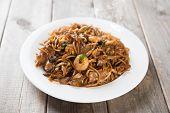 Fried Char Kuey Teow, popular noodle dish in Malaysia and Singapore. poster