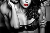 Sensual woman in underwear with young lover passionate couple foreplay closeup black and white selective coloring poster