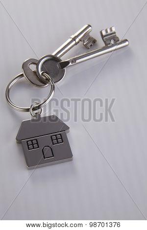 House shaped key chain with keys