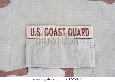 Kiev, Ukraine - June 14, 2015. Us Coast Guard Branch Tape On Desert Camouflage Uniform