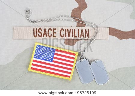 KIEV UKRAINE - June 14 2015. USACE CIVILAN branch tape with dog tags and flag patch on desert camouflage uniform poster