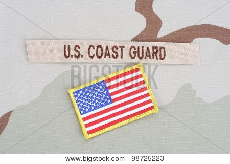 Kiev, Ukraine - June 14, 2015. Us Coast Guard Branch Tape With Flag On Desert Camouflage Uniform