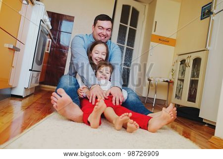 happy family at home on the floor