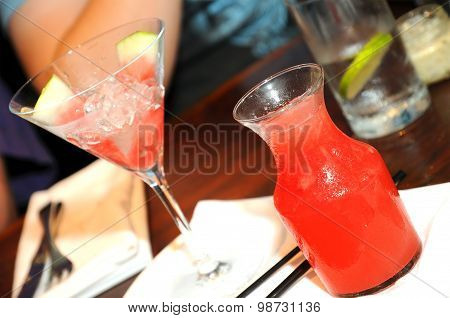 Gourmet restaurant concept - a watermelon cocktail in a small can with a glass is served on the dinn